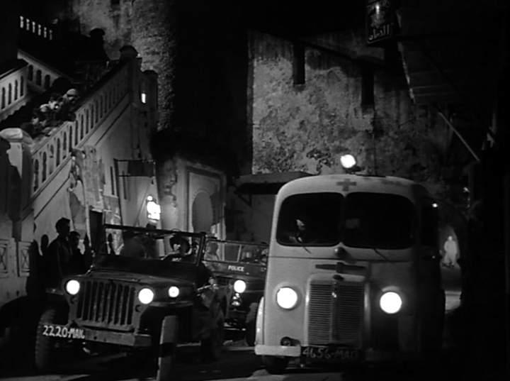 """Filmscene aus dem Krimi """"La Mome de Vert Gris"""" mit Eddy Constantine aus dem Jahr 1953"""